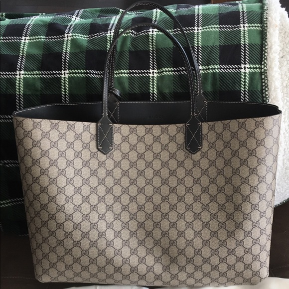 00763508e3b9 Gucci Handbags - Gucci reversible GG medium tote